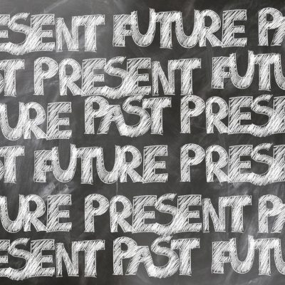 past-present-future- traditional tenses written on a blackboard - the old warped view of tenses - in jumbled order. This traditional way of looking at English tenses is confusing!